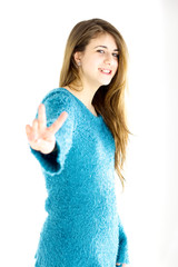 Happy female teenager victory sign isolated
