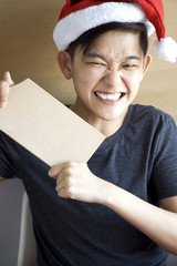 excited young asian showing blank board