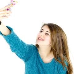 Happy girl taking selfie in studio