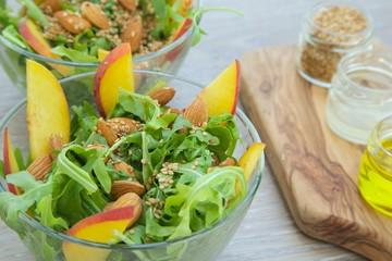 Vitamin salad- rucola with nuts and fruits