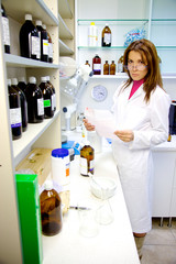 Woman working in lab with creating medicine