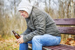 Man with beer bottle in the park
