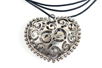Silver heart pendant necklace on white