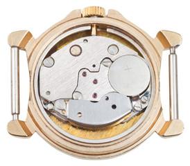 quartz clock mechanism in old golden watch