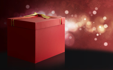 Gift Box over a red and black Christmas background.