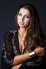 Portrait of the young sexy woman in black tunic Arabic