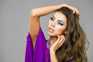 Portrait of the young sexy woman in purple  tunic Arabic