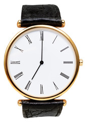 seven o'clock on dial of wristwatch