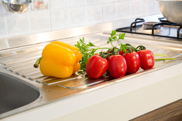 Yellow peppers, red tomatoes and parsley