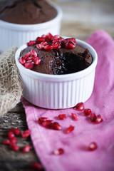 Molten chocolate coffee cake with pomegranate and soft centre