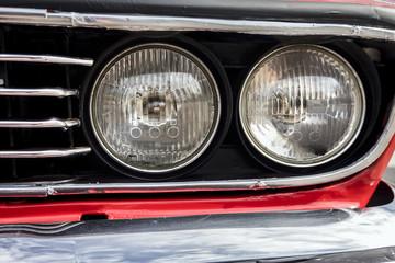 Closeup of the headlights of car