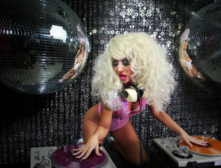 sexy female drag artist Djing