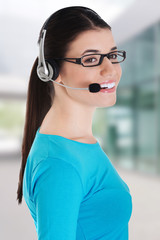 Casual woman with microphone and headphones.