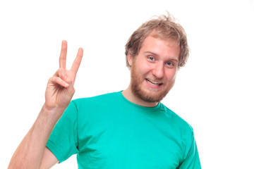 Bearded happy man showing victory sign