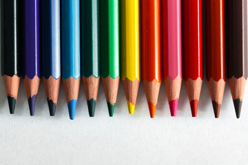 Colorful pencils arranged as a color pallete, isolated.