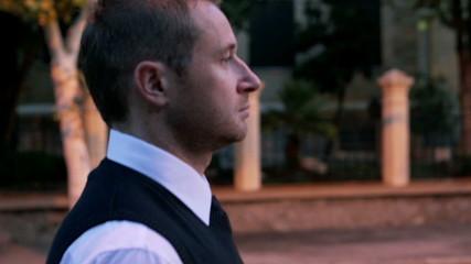 Businessman walking on the street, steadycam shot