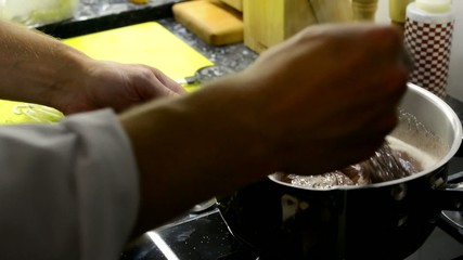 chef prepares food - dessert - chef cook chocolate on stove