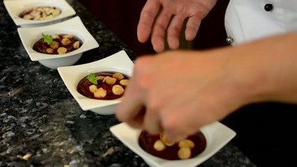chef prepares food - dessert - kitchen - closeup