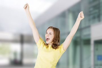 Excited happy success young woman