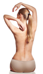 Backache. Young female with naked back