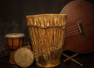old music instruments -Djembe drums and acoustic bass guitar