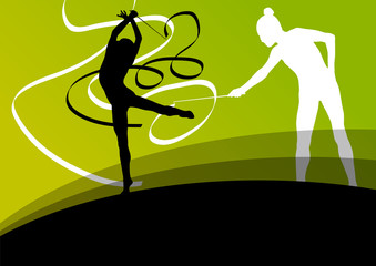 Active young girl gymnasts silhouettes in acrobatics flying ribb