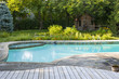 Swimming pool in backyard - 73538675