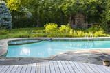 Swimming pool in backyard - 73538675