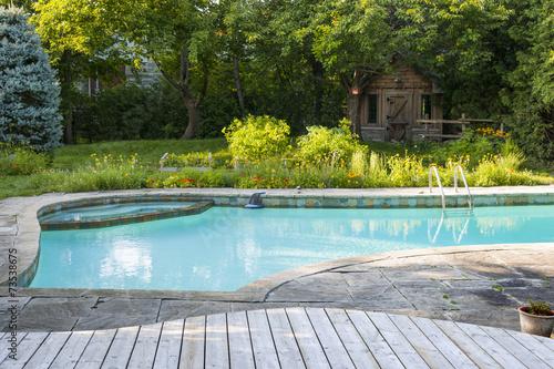 Leinwanddruck Bild Swimming pool in backyard