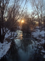 Winter sunset by the brook