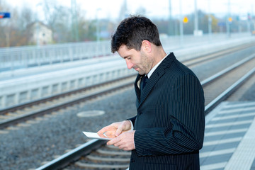 man in suit on business trip using tablet PC