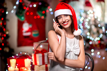 Young woman using mobile phone on Christmas