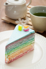 Rainbow crape cake on plate. (Selective Focus)