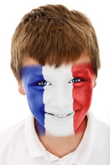 Young boy with french flag painted on his face