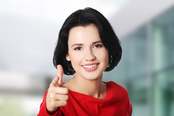 Young beautiful caucasian woman pointing on you
