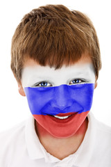 Young boy with Netherlands flag painted on his face