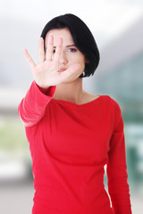Confident woman making stop gesture