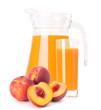 Peach fruit juice in glass jug