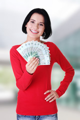Cheerful young lady holding polish cash