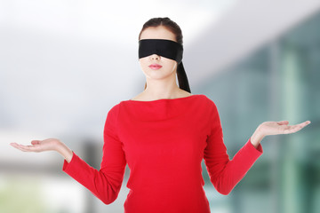 Blindfold woman presenting copy space