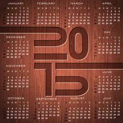 Engraved 2015 Calendar illustration on wood background.