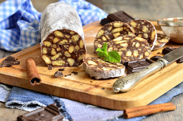 Chocolate salami with biscuits.