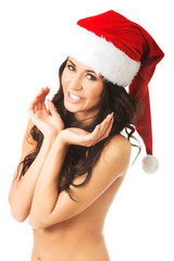 Portrait of woman shirtless wearing santa hat