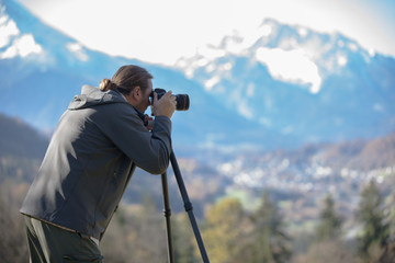 Photgrapher taking picture of  a  mountain