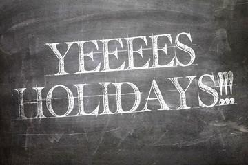 Yeeees Holidays!!! written on blackboard