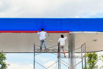 Two man working on scaffolding