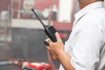 Man using walkie talkie