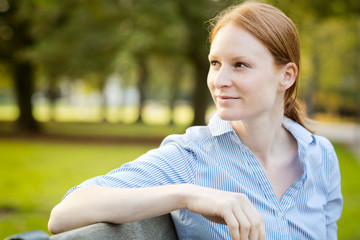Businesswoman Waiting for a Meeting in a Park