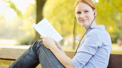Female Student with a Book in a Park