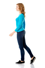 Side view of a woman walking slowly